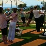 Yoga Gruppe Outdoor am Meer